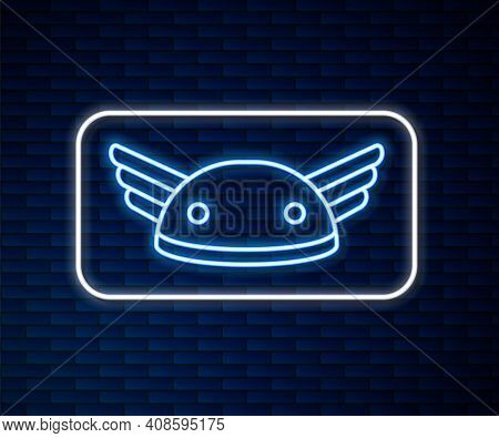 Glowing Neon Line Helmet With Wings Icon Isolated On Brick Wall Background. Greek God Hermes. Vector