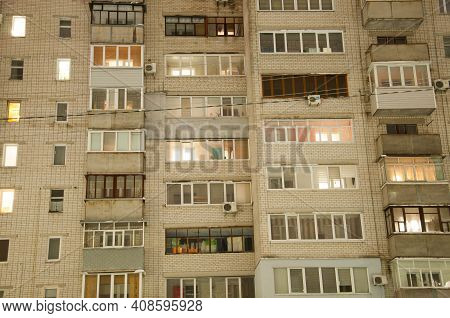 Pryluky, Chernihiv, Ukraine - 02/15/2021: Multi-storey Brick House In The Evening With Lights In The