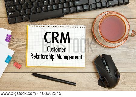 Office Desk And Notebook With Text - Crm Customer Relationship Management, Keyboard And A Cup Of Tea