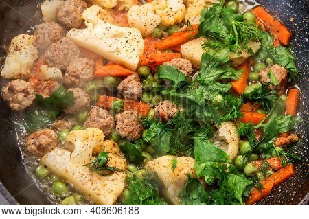 Stewed Vegetables And Meat In A Frying Pan. Cauliflower And Carrots. Steamed Meatballs And Vegetable