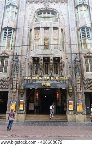 Amsterdam, Netherlands - July 10, 2017: People Walk By Movie Theater Pathe Tuschinski In Amsterdam.