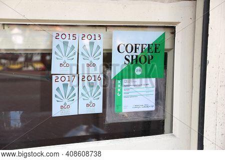 Amsterdam, Netherlands - July 10, 2017: Legal Permit In A Window Of A Coffee Shop In Amsterdam, Neth