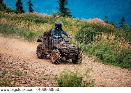 Atv Rider Rides Through Forest Off-road In Summer