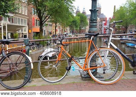 Amsterdam, Netherlands - July 10, 2017: Bicycles Parked At Oudezijds Voorburgwal In Amsterdam, Nethe