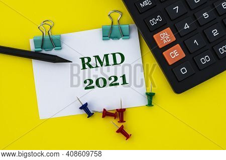Rmd (required Minimum Distribution) - Acronym On A White Sheet With Clips On A Yellow Background Wit