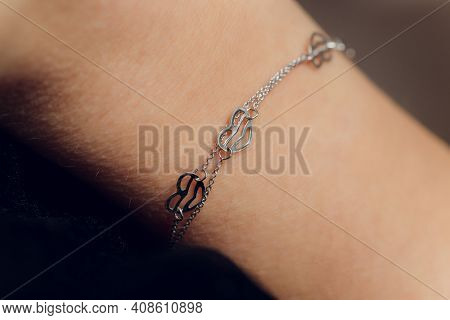 Close Up Detail Of A Bracelet On A Female Hand Model - Image Of A Beautiful Sparkling Fashion Access
