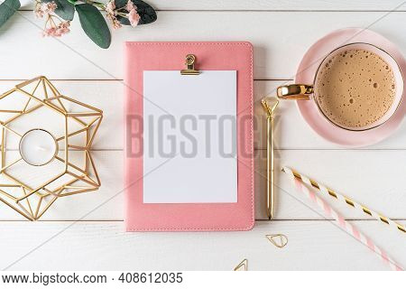 Top View Of White Working Table Background With Blank Paper Notebook, Cup Of Coffee. Flat Lay Green