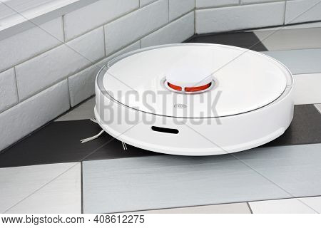 A Robot Vacuum Cleaner Helps In Cleaning An Apartment Or House.