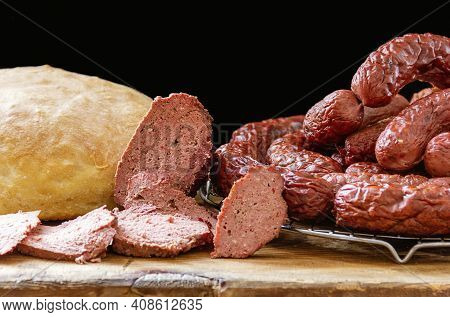 Homemade Venison Sausage On A Chopping Board And Homemade Bread