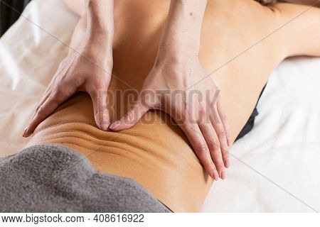 Relaxed Young Woman Having Healing Body Massage. Female Therapist Rubbing Lady's Back, Giving Her Re