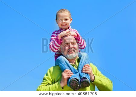 Grandfather and grandaugther smaile and happy together poster