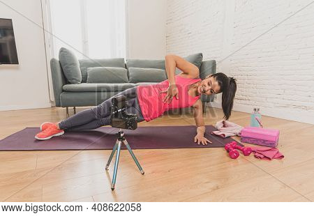 Woman Personal Coach Trainer Recording Online Fitness Class On Camera At Home