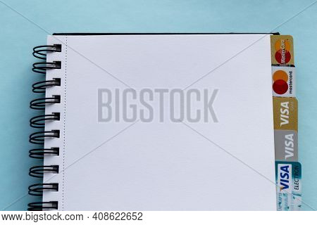 Moscow, Russia, August 2019: Notepad With Credit Cards: Visa, Visa Gold, Visa Electron And Mastercar