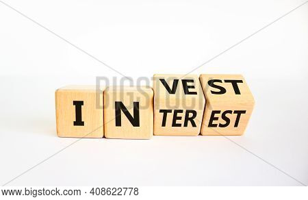 Invest Or Interest Symbol. Turned Wooden Cubes And Changed The Word 'invest' To 'interest'. Beautifu