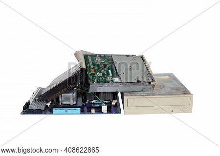 Pile Of Electronic Waste, Rusty Old And Obsolete Computer Hardware Such As Motherboards And Cd-roms,