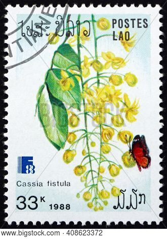 Laos - Circa 1988: A Stamp Printed In Laos Shows Golden Shower, Cassia Fistula, Flowering Plant, Cir