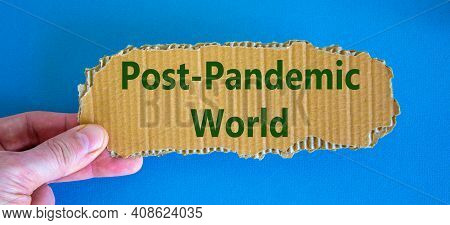 Post-pandemic World Symbol. Concept Words 'post-pandemic World' On Cardboard Between Fingers. Beauti