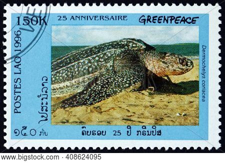Laos - Circa 1996: A Stamp Printed In Laos Shows Leatherback Sea Turtle On Sand, Dermochelys Coriace