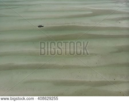 Aerial Shot Of Low Tide Sea Bottom Sand Waves Pattern. Long Shallow Indian Ocean Shoal