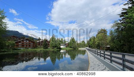 Houses And White Lake At Crans Montana, Switzerland