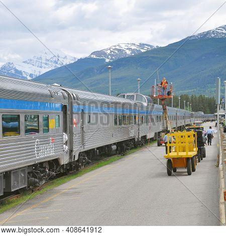 Jasper, Canada - June 15, 2011: Passenger Train From Vancouver Stands At Jasper Station Platform Aft