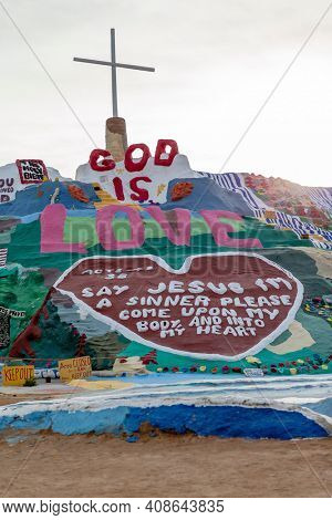 NILAND, CALIFORNIA- MAR 11: Historic Salvation Mountain in Niland, California on March 11, 2019. Salvation Mountain was proclaimed a National Treasure by Congress on May 15, 2002.