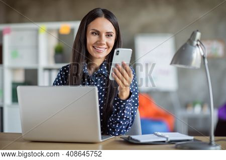 Photo Of Young Lovely Pretty Attractive Cheerful Smiling Businesswoman Using Phone Work In Laptop At