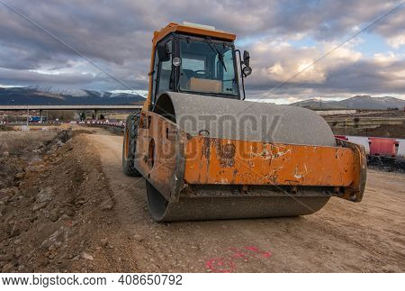 Steamroller Performing Leveling Work On A Road Under Construction
