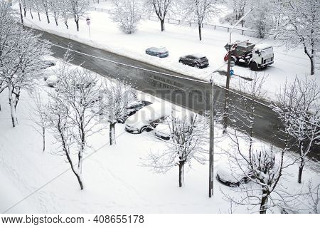 Snowy Winter City View From The Window. Snowstorm And Snow Covered Street And Cars