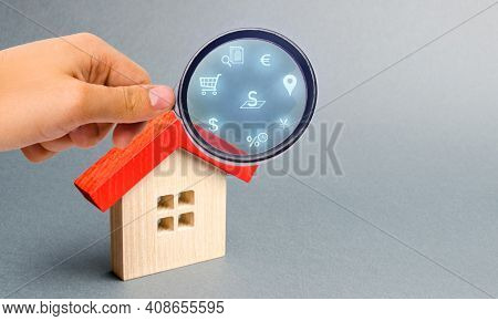 Realtor Examines Houses Through A Magnifying Glass. Review Of The Real Estate Market, Search For The