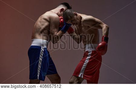 Battle Of Boxers Two Fighting Males In Boxing Gloves In Red Studio Light, Martial Arts, Mixed Fight