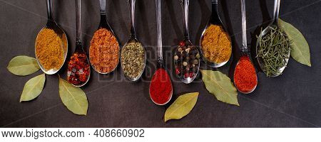 Various Herbs And Spices On Black Background.