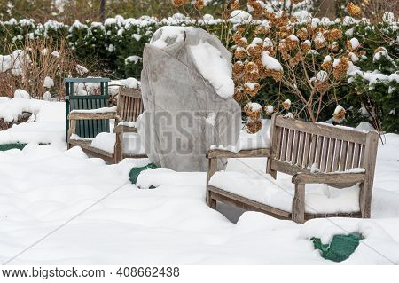 Plants And Trees In A Park Or Garden Covered By The Snow And Blanket, Swath Of Burlap, Frost Protect
