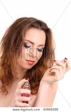Young woman applying perfume isolated on white