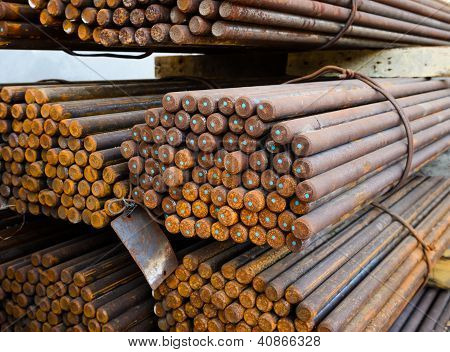 Rust Reinforcing steel rod or bars in warehouse poster