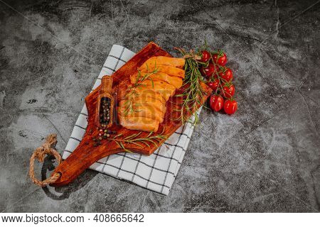 Marinated Chicken Fillet Pieces In Red Marinade On A Wooden Kitchen Board With Spices. Raw Marinated