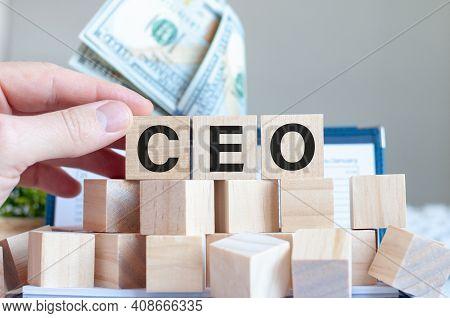 The Word Ceo On The Wooden Blocks And A Bank With Money In The Background, Business Concept. Ceo - C