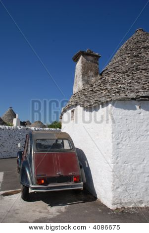 Maroon Car Outside Trullo