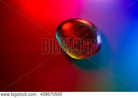 Tumbled Mineral Gem Colorfully Illuminated Showing Abstract Details.