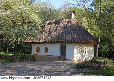 Wooden Houses In Colored Trees Taken In Park In Autumn In Pirogovo Museum, Kiev, Ukraine