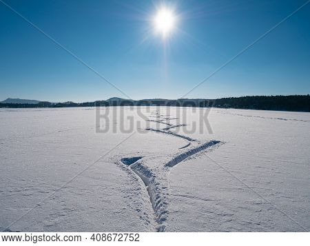 Amazing Cutouts Of Ice Skater Tracks In Dusty Snow.  View Of Open Frozen Lake Or Pond With Huge Spac