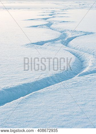 Amazing Cutouts Of Ice Skater Tracks In Dusty Snow. Freeze Blue Snow With Glittering Dots