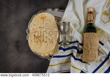Jewish Pesach Attributes In Composition A Cup Full Of Wine And Passover Matzah