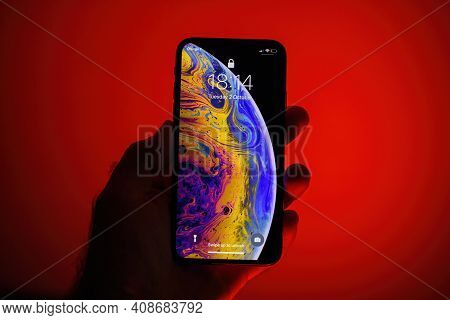 Paris, France - Oct 2, 2018: Pov Male Hand Holding New Apple Computers Iphone Xs 11 12 13 Pro Latest