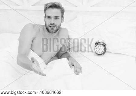 Man Sleeping Bed White Bedclothes And Red Alarm Clock, Morning Awakening Concept.