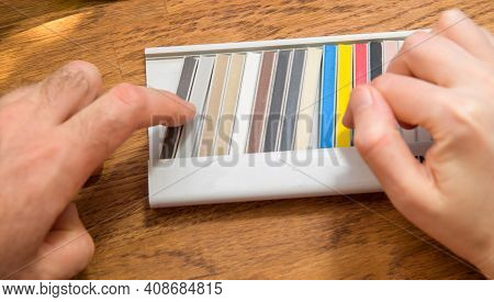 Overhead View Pov Male Worker Hand Choosing Multiple Sample Colorful Sticks With Expansion Joints Sa