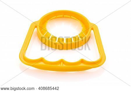 Handles For Pet Bottle. Closeup. The Handle Is Plastic Yellow On White Background. Special Handle Fo