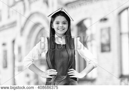 Every Child Is Born With Imagination. Little Girl Hold Book On Head. Reading Lesson. School Time. Ch