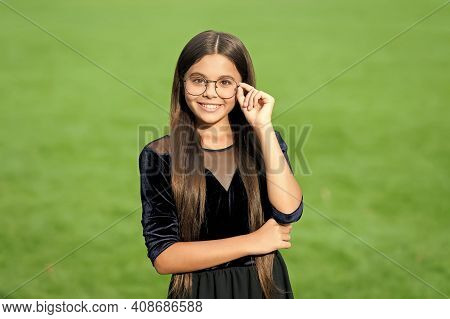 Happy Little Kid With Long Brunette Hair In Fashion Black Dress Fix Corrective Glasses With Beauty L