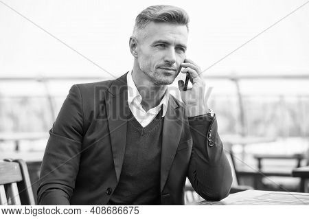 Fixing Formal Meeting. Handsome Man Make Call In Outdoor Cafe. Business Communication. Serious Lawye